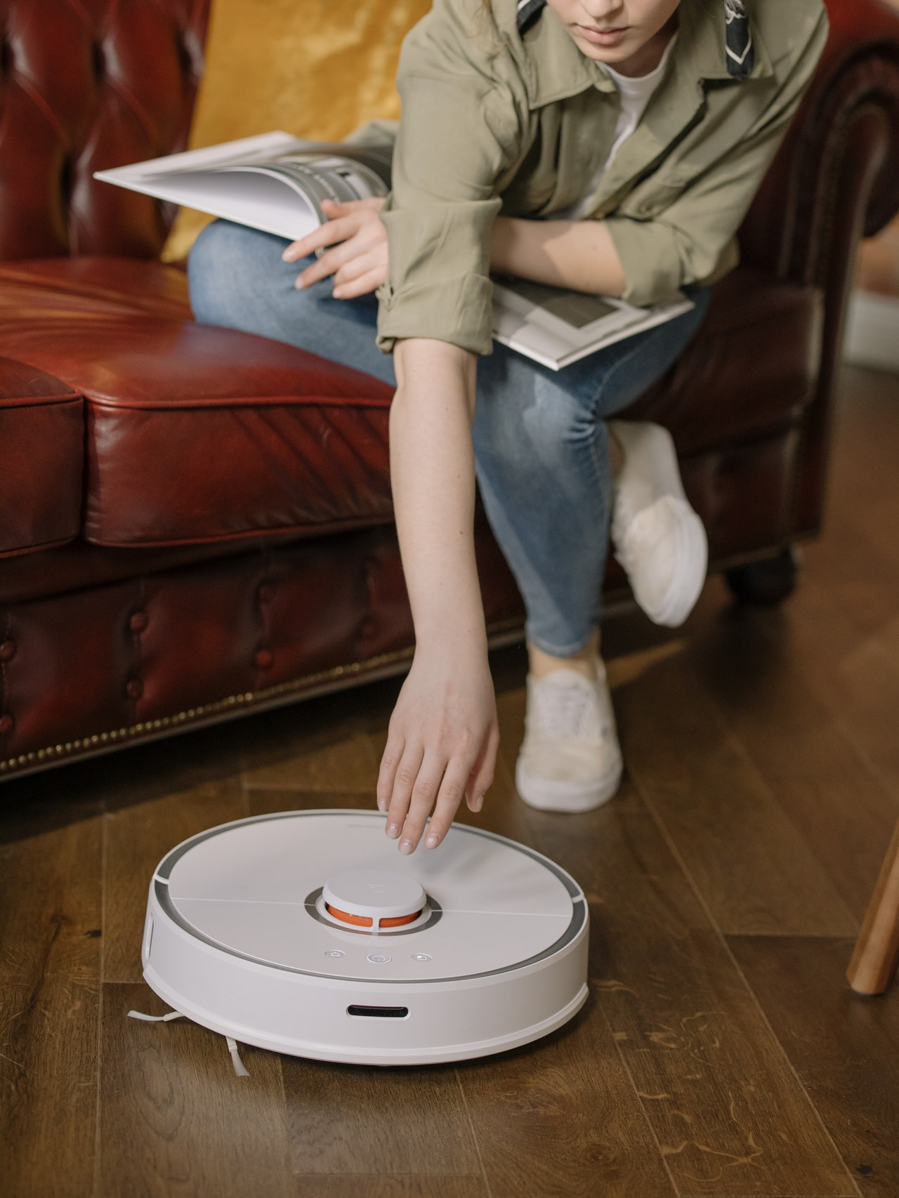 woman using robot vacuum cleaner