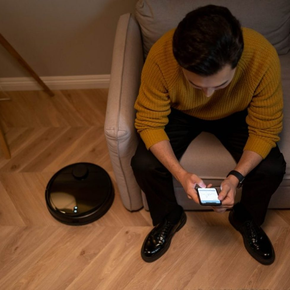 man sitting with smart home gadgets